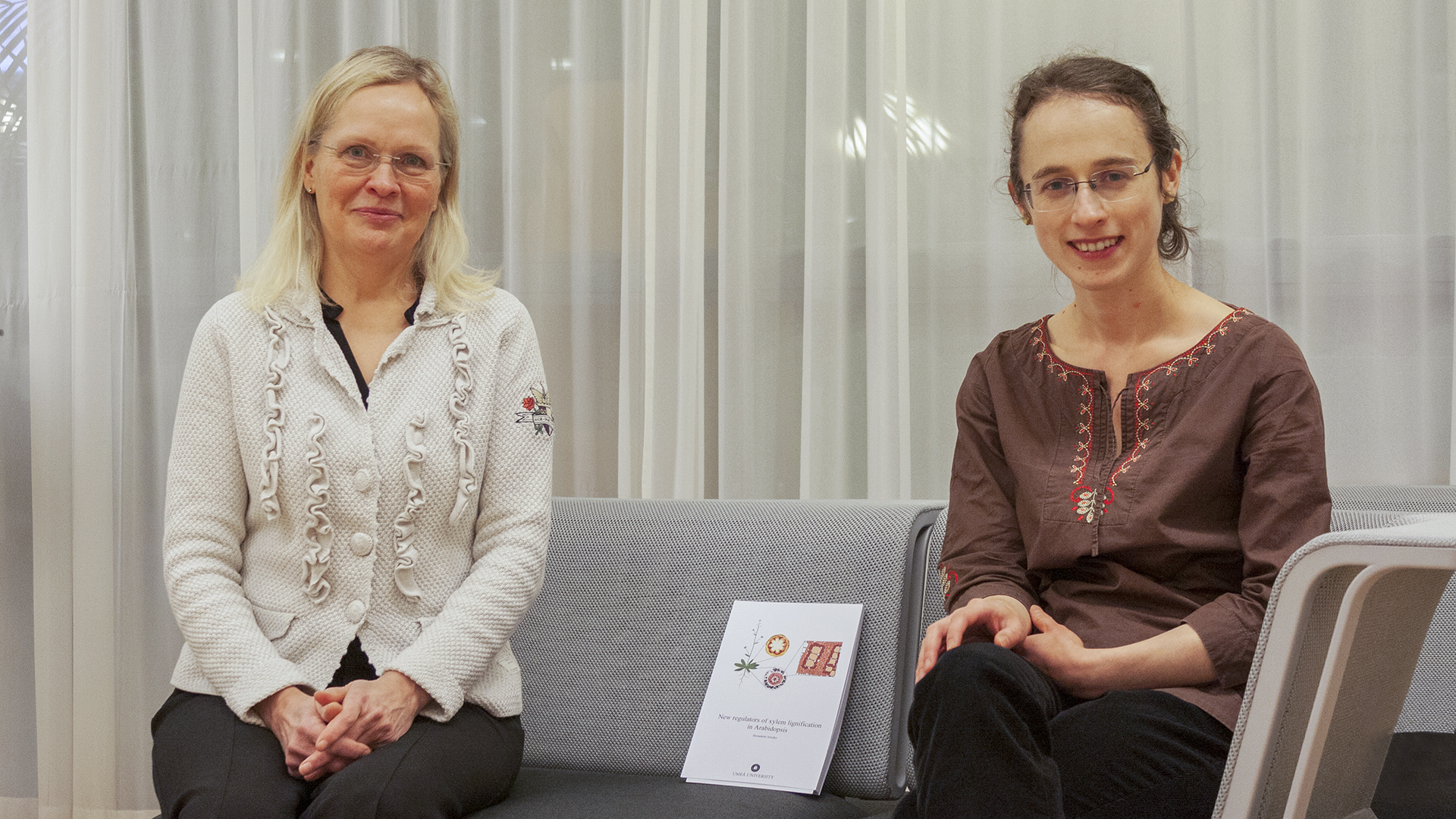 Bernadette Sztojka (right) and her supervisor Hannele Tuominen (left) chatting after Bernadette's defence